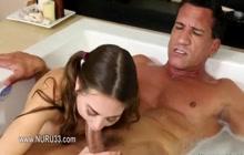 Teen giving head in a bathtub