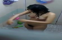 Thai girl takes a bath