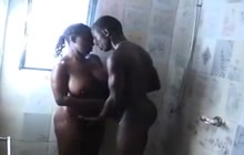 Black couple fucks under the shower